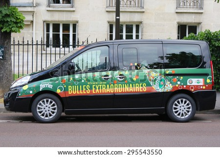 PARIS, FRANCE- MAY 26, 2015: Peugeot van with Perrier logo at Le Stade Roland Garros in Paris. Perrier and Peugeot are Official Partners of the tournament for more than 30 years.  - stock photo
