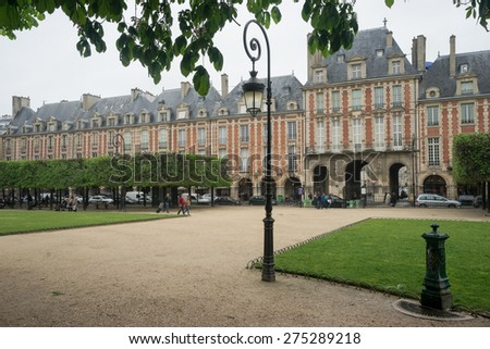 PARIS, FRANCE - MAY 02: Places des Vosges, The carrying royal square is located on the lively Marais district. PARIS  on MAY 02, 2015.