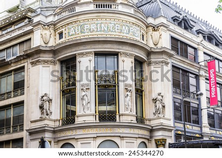 PARIS, FRANCE - MAY 10, 2014: Printemps (founded in 1865) in Paris - largest beauty Department Store in world with 45000 square meters of shopping. Printemps facade (registered as Historic Monument).