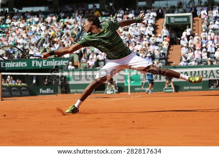 PARIS, FRANCE- MAY 27, 2015: Professional tennis player Gael Monfis  of France during second round match at Roland Garros 2015 in Paris, France - stock photo