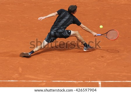 PARIS, FRANCE- MAY 29, 2015: Professional tennis player Gilles Simon of France in action during his third round match at Roland Garros 2015 in Paris, France - stock photo