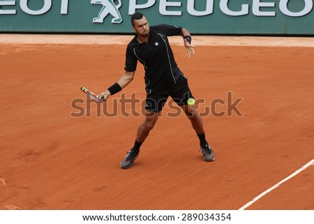PARIS, FRANCE- MAY 29, 2015: Professional tennis player Jo-Wilfried Tsonga of France during third round match at Roland Garros 2015 in Paris, France - stock photo