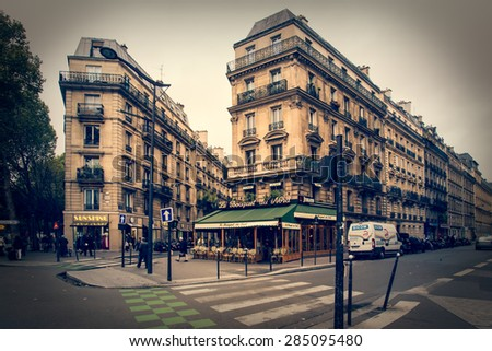 PARIS, FRANCE - MAY 9, 2014:  Quaint retro style street scene  taken in Paris France.  - stock photo