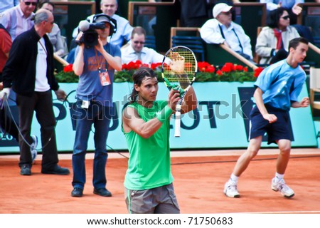 PARIS, FRANCE - MAY 28: Rafael Nadal from Spain celebrates victory after his match against Thomaz Bellucci at Roland Garros on May 28, 2008 in Paris, France. Rafael Nadal went on to win the tournament. - stock photo