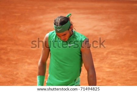 PARIS, FRANCE - MAY 28: Rafael Nadal from Spain during his first round match against Thomaz Bellucci at Roland Garros on May 28, 2008 in Paris. Rafael Nadal went on to win the tournament. - stock photo