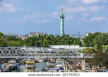 PARIS, FRANCE - MAY 18, 2014: Row of houseboats docked on Canal Saint Martin - a 4,5 km long canal; it connects canal de l'Ourcq to river Seine.