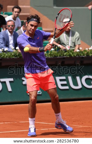 PARIS, FRANCE- MAY 27, 2015: Seventeen times Grand Slam champion Roger Federer during first round match at Roland Garros 2015 in Paris, France - stock photo