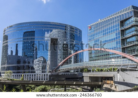 PARIS, FRANCE - MAY 15, 2014: Skyscrapers in business district of Defense to the west of Paris. Defense is biggest business district in France and most of large companies have offices here.