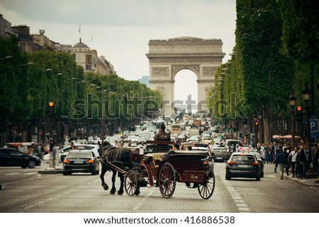PARIS, FRANCE - MAY 13: street view and Arc de Triomphe on May 13, 2015 in Paris. With the population of 2M, Paris is the capital and most-populous city of France - stock photo
