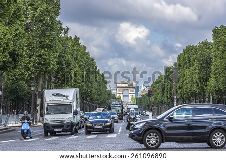 PARIS, FRANCE - MAY 14, 2014: The Champs-Elysees and the Arc de Triomphe. Champs-Elysees - the most famous avenue of Paris has 1910m and is full of stores, cafes and restaurants.