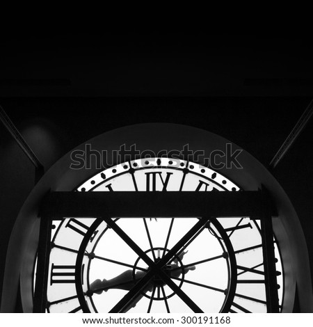 Paris, France - May 14, 2015: The clock with roman numerals in the museum D'Orsay. The museum houses the largest collection of impressionist and post-impressionist masterpieces in the world. - stock photo