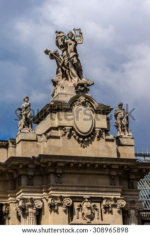 PARIS, FRANCE - MAY 14, 2014: The Grand Palais des Champs-Elysees. Grand Palais in Beaux-Arts architecture style was built for Universal Exposition of 1900 and made of glass, iron, steel and concrete.