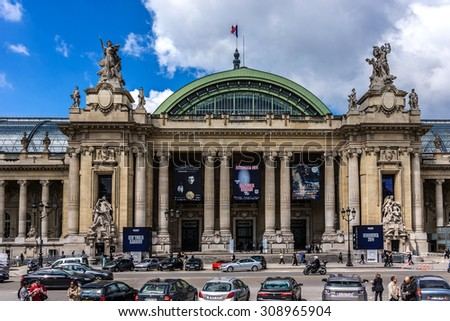 PARIS, FRANCE - MAY 14, 2014: The Grand Palais des Champs-Elysees. Grand Palais in Beaux-Arts architecture style was built for Universal Exposition of 1900 and made of glass, iron, steel and concrete. - stock photo