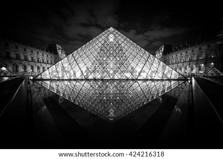 PARIS, FRANCE - MAY 18 2016: The Louvre at night is one of the world's largest museums in Paris, May 18, 2016 - stock photo