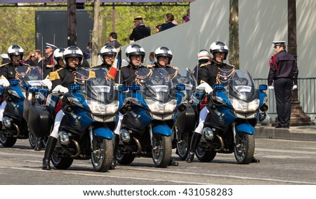 Paris, France-May 08; 2016 : The motorcycle escort of French President on Champs Elysees avenue in Paris during commemoration of Victory day in World War II.