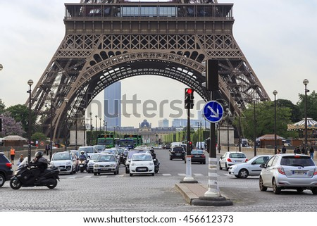 PARIS, FRANCE - MAY 12, 2015: This is a view of the Champ de Mars, across the bridge of Jena and the base of the Eiffel Tower.