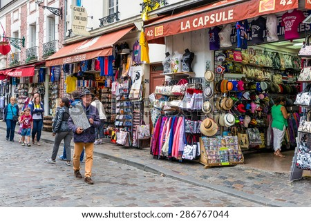 PARIS, FRANCE - May 28: Tourists and street artists walking near the gift shops of Montmartre, close to the famous Sacre Coeur Basilica on May 28, 2015, Paris, France - stock photo