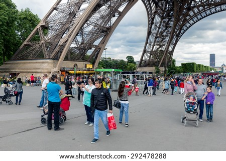 PARIS, FRANCE - May 28: Tourists near the Eiffel tower, main attraction of Paris  on May 28, 2015, Paris, France