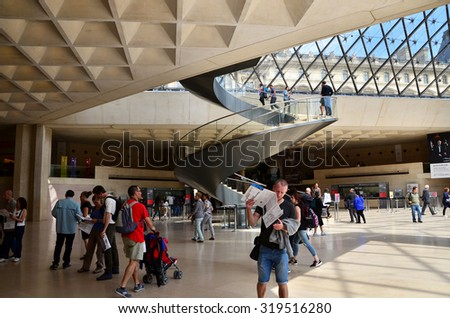 Paris, France - May 13, 2015: Tourists visit Interior of Louvre museum on May 13, 2015 in Paris. Louvre is one of the biggest Museum in the world, receiving more than 8 million visitors each year.  - stock photo