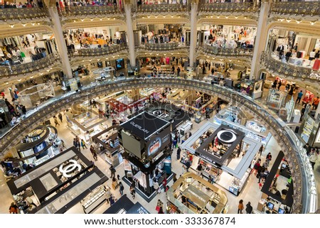 PARIS, FRANCE - MAY 29: Unknown people shopping in famous luxury Lafayette department store on May 29, 2015 in Paris, France - stock photo