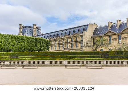 PARIS, FRANCE - MAY 13, 2014: View of Louvre building at courtyard of Louvre Museum. With 8.8 million annual visitors, Louvre is consistently the most visited museum worldwide. - stock photo
