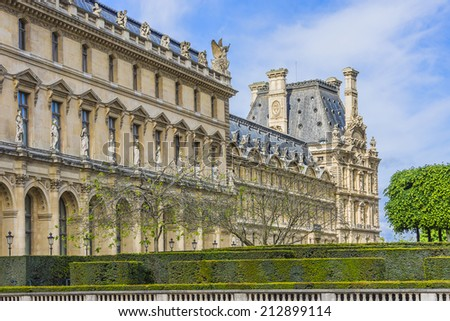 PARIS, FRANCE - MAY 8, 2014: View of Louvre building at courtyard of Louvre Museum. With 8.8 million annual visitors, Louvre is consistently the most visited museum worldwide.