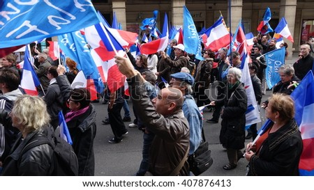 PARIS, FRANCE - MAY 1, 2014: Worker Protesters Mayday marching during a demonstration in city center against government's New Law  to extent the 'state of emergency' and for opened borders