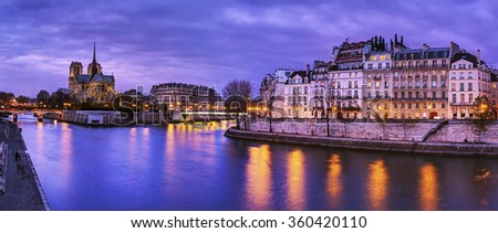 Paris, France: Notre Dame at dusk with Seine river on foreground