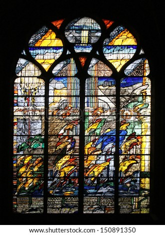 PARIS, FRANCE - NOV 07, 2012: Abstract stained glass, church is dedicated Gervasius and Protasius is one of the oldest in Paris. Known for its richly painted stained glass, Paris on Nov 07, 2012 - stock photo