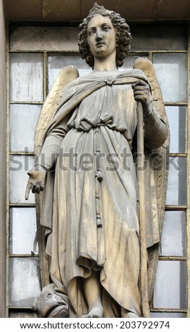 PARIS, FRANCE - NOV 09, 2012: Archangel Raphael, architectural details of Eglise de la Madeleine. Church was designed in its present form as a temple to the glory of Napoleon's army.