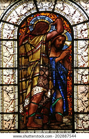 PARIS, FRANCE - NOV 10, 2012: Baptism of the Lord, stained glass, Saint-Vincent-de-Paul Church (design Jean-Baptiste Lepere, was built during 1824 - 1844) dedicated to Saint Vincent de Paul - stock photo