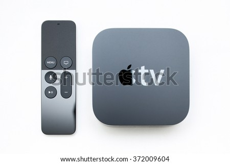 PARIS, FRANCE - NOV 10, 2015: Focus on the remote control of the New Apple TV media streaming   by Apple Computers next to the new touch remote with integrated Siri and motion sensor on white  - stock photo