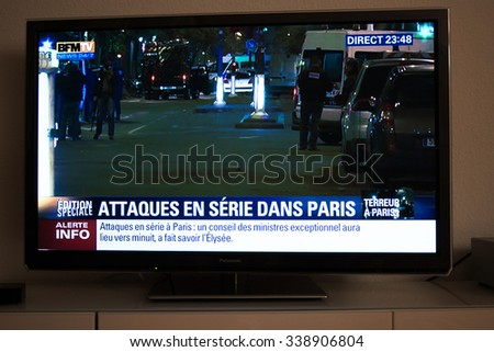 PARIS, FRANCE - NOV 13, 2015: French Television reporting live as rescuers working on the scene of the attack. At least 40 people were killed across Paris, with explosions outside the national stadium - stock photo