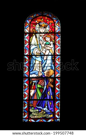 PARIS,FRANCE NOV 07: Madonna with Child, Notre-Dame de Clignancourt church located in the 18th arrondissement of Paris. Completed in 1863. Windows are from the Art Deco period. On Nov 07 in Paris