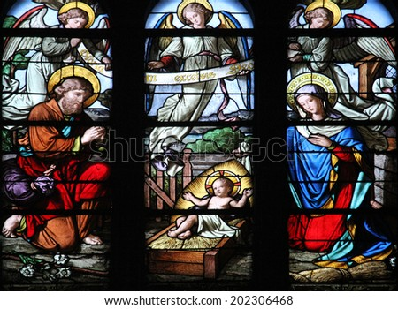 PARIS, FRANCE - NOV 05,2012: Nativity Scene stained glass in Church of St Eustace. Church was built in 1532-1632 and considered a masterpiece of late Gothic architecture, in Paris on Nov 05,2012. - stock photo