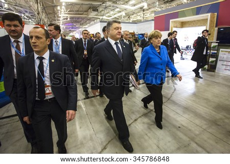 PARIS, FRANCE - Nov 30, 2015: President of Ukraine Petro Poroshenko and Chancellor of the Federal Republic of Germany Angela Merkel in the course of the UN Climate Conference in Paris - stock photo