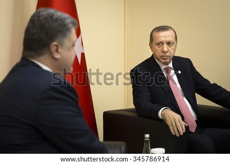 PARIS, FRANCE - Nov 30, 2015: President of Ukraine Petro Poroshenko and Turkish President Recep Tayyip Erdogan in the course of the UN Climate Conference in Paris - stock photo