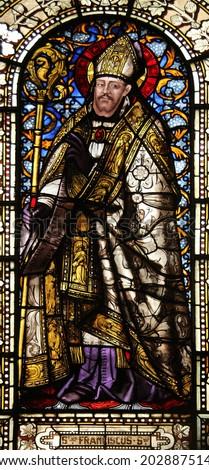 PARIS, FRANCE - NOV 10, 2012: Saint Francis de Sales, stained glass, Saint-Vincent-de-Paul Church (design Jean-Baptiste Lepere, was built during 1824 - 1844) dedicated to Saint Vincent de Paul - stock photo