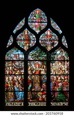 PARIS, FRANCE - NOV 11, 2012: Saint Mary Magdalene, stained glass. The Church of St Severin is Catholic church in the Latin Quarter. It is one of the oldest churches on the Left Bank. - stock photo