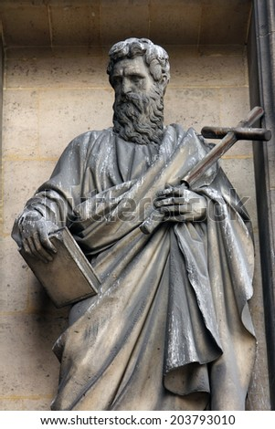 PARIS, FRANCE - NOV 09, 2012: Saint Philip the Apostle, architectural details of Eglise de la Madeleine. Church was designed in its present form as a temple to the glory of Napoleon's army.