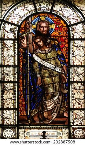 PARIS, FRANCE - NOV 10, 2012: Savior, stained glass, Saint-Vincent-de-Paul Church (design Jean-Baptiste Lepere, was built during 1824 - 1844) dedicated to Saint Vincent de Paul - stock photo