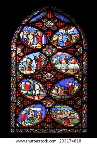 PARIS, FRANCE - NOV 11, 2012: Scenes from the life of the Christ, stained glass from Church of St-Germain-l'Auxerrois founded in the 7th century, was rebuilt many times over several centuries. - stock photo
