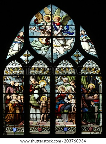 PARIS, FRANCE - NOV 11, 2012: St. John the Baptist introduced by his mother, St. Elizabeth, the Infant Jesus and the Holy Kinship.The Church of St Severin is Catholic church in the Latin Quarter. - stock photo