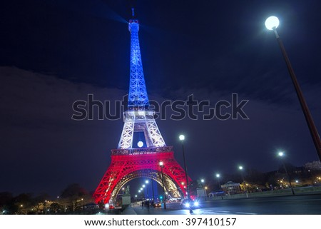 PARIS. FRANCE. NOV 24, 2015: The Eiffel tower illuminated up with the colors Of the French national flag to honor the victims terrorist attacks in Paris. November 24, 2015. Paris.