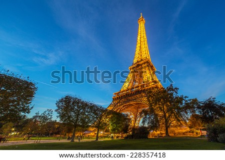 PARIS, FRANCE - NOVEMBER 1: A view of illuminated Eiffel Tower in the evening on November 1, 2014. Eiffel Tower is the most popular tourist attraction in France.