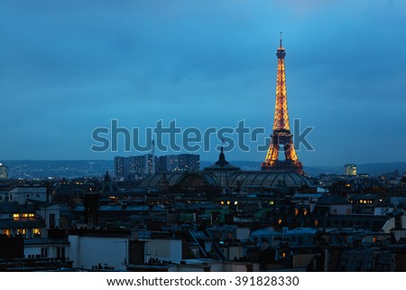 PARIS, FRANCE - NOVEMBER 19, 2013: aerial view of Paris at night, with the illuminated Eiffel Tower. The world famous Eiffel Tower is the main landmark of Paris - stock photo