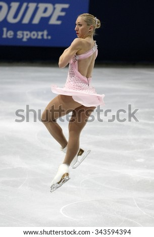 PARIS, FRANCE - NOVEMBER 16, 2013: Amelie LACOSTE of Canada performs free program at Trophee Bompard ISU Grand Prix at Palais Omnisports de Bercy. - stock photo