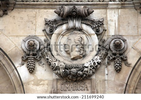 PARIS, FRANCE - NOVEMBER 08, 2012: Architectural details of Opera National de Paris: Cimarosa Facade sculpture. Grand Opera is famous neo-baroque building in Paris, France. UNESCO World Heritage Site.