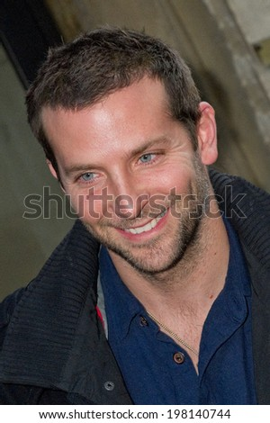 PARIS, FRANCE - NOVEMBER 30, 2011 - Bradley Cooper before the recording studios of the French radio Europe 1  - stock photo