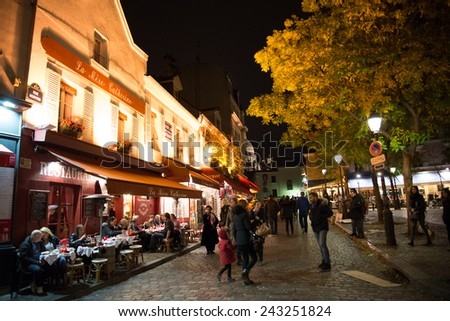 PARIS, FRANCE -  NOVEMBER 10, 2014 Cafe and Restaurant in Montmartre famous artist painting spot at night in Paris, France - stock photo